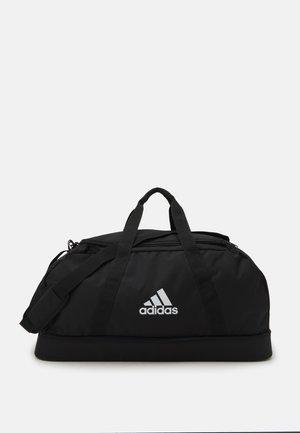 TIRO DUFFEL L UNISEX - Sportovní taška - black/white