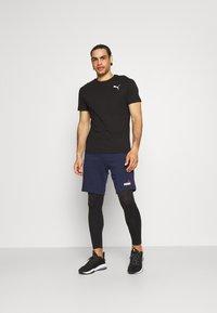 Puma - SEAMLESS BODYWEAR LONG - Leggings - black - 1