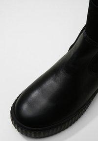 Pajar - CALINE - Kotníkové boty na platformě - black - 2