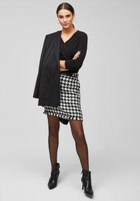 s.Oliver BLACK LABEL - MIT CACHE-COEUR-AUSSCHNITT - Long sleeved top - black - 1