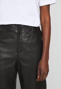 Filippa K - KARLIE TROUSER - Leather trousers - black - 3