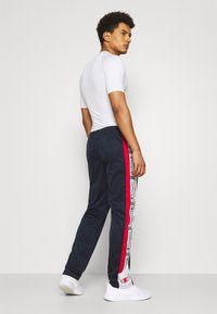Champion - STRAIGHT HEM PANTS - Tracksuit bottoms - dark blue - 2