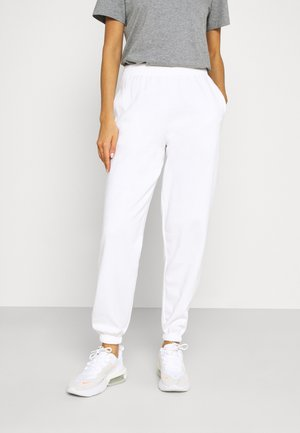 CUFFED - Tracksuit bottoms - white