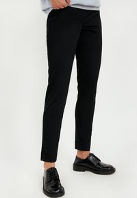 Finn Flare - Trousers - black - 0