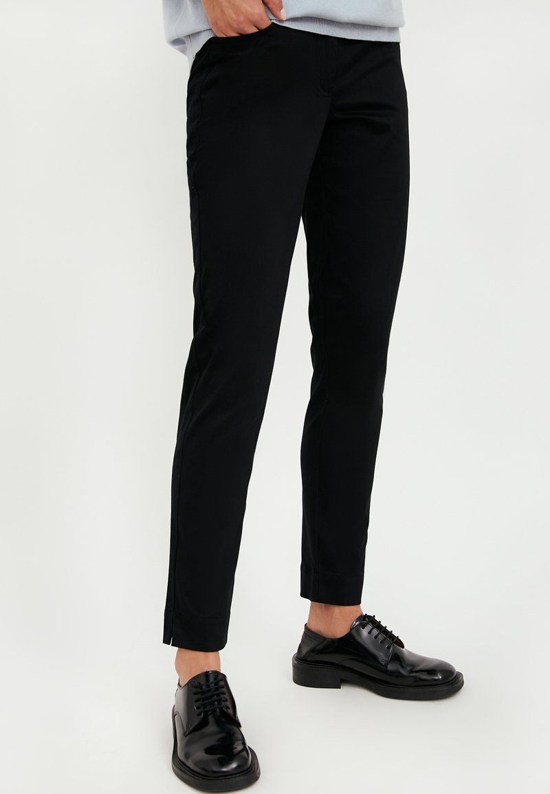 Finn Flare - Trousers - black