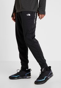 The North Face - LOGO JOGGER - Verryttelyhousut - black - 0