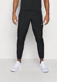 Nike Performance - ESSENTIAL PANT - Tracksuit bottoms - black/reflective silver - 0