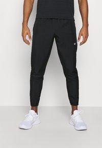 Nike Performance - ESSENTIAL PANT - Verryttelyhousut - black/reflective silver - 0
