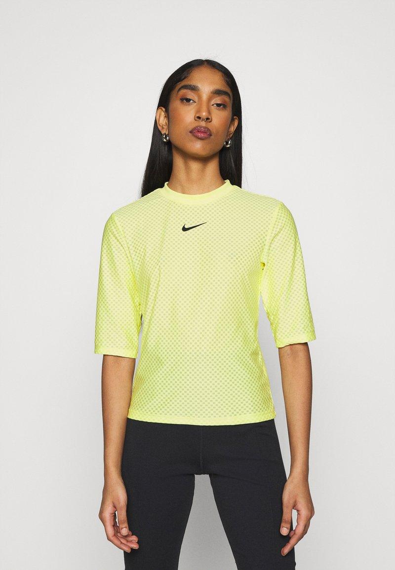 Nike Sportswear - T-shirt imprimé - light zitron/black
