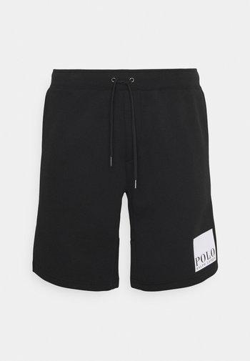 TECH - Träningsbyxor - black