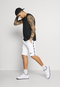 Nike Sportswear - REPEAT  - Shorts - white/black - 1