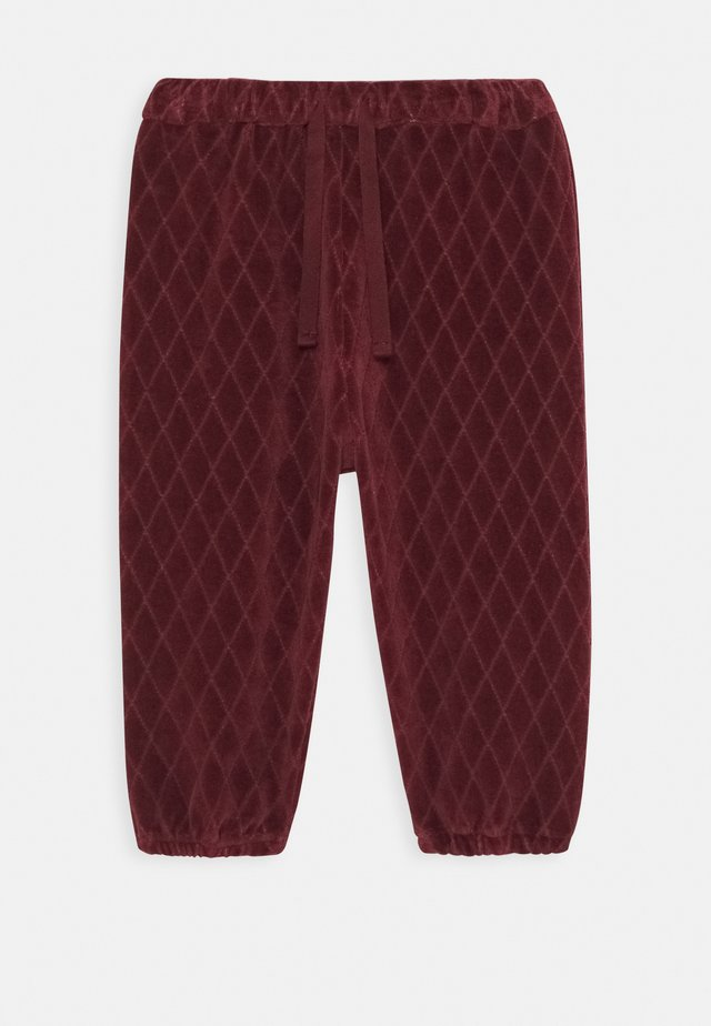KHYA PANTS - Tracksuit bottoms - rose brown