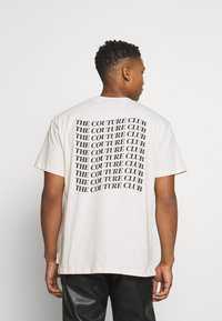 The Couture Club - RELAXED FIT T-SHIRT WITH WAVE BACK PRINT - Print T-shirt - whisper white - 2