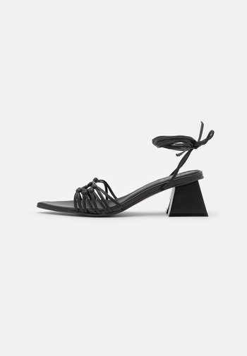MIRAGE - Sandaalit nilkkaremmillä - black