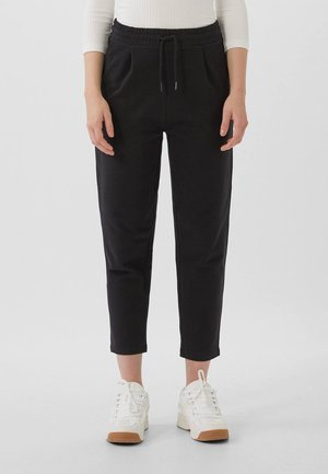 MIT KORDELZUG - Tracksuit bottoms - black