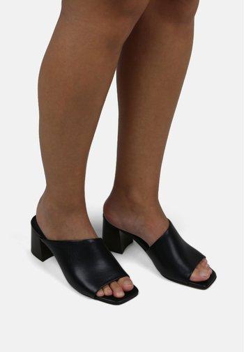 ECLIPSE ASYMMETRIC MULE - Mules à talons - black