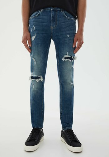 MIT ZIERRISSEN AM HOSENBEIN - Slim fit jeans - blue denim