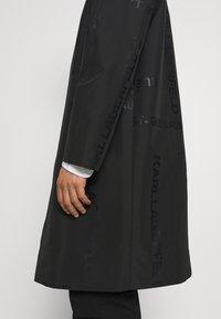 KARL LAGERFELD - UNISEX - Waterproof jacket - black - 3