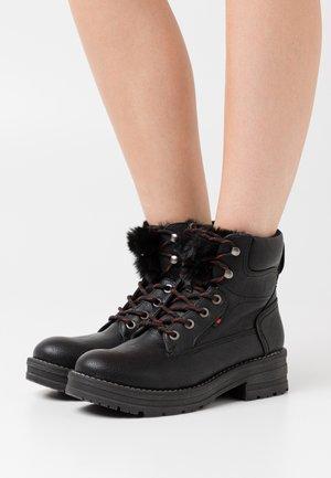 HANZEL - Platform ankle boots - black