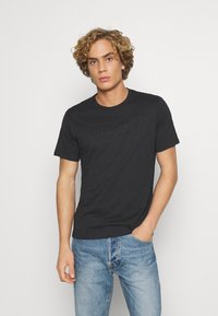 Levi's® - HOUSEMARK GRAPHIC TEE UNISEX - T-shirt con stampa - blacks - 0