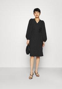 JUST FEMALE - TODA WRAP DRESS - Day dress - black - 1