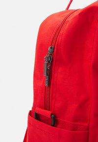 Fila - COATED CONVERTIBLE MID BACKPACK UNISEX - Rucksack - true red - 4