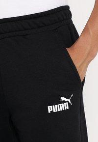Puma - BERMUDAS - Träningsshorts - black - 3