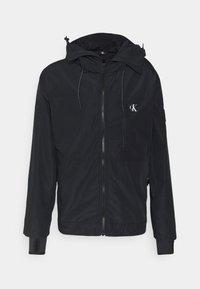 Calvin Klein Jeans - TECHNICAL 2 IN 1 UTILITY JACKET - Waistcoat - black - 2