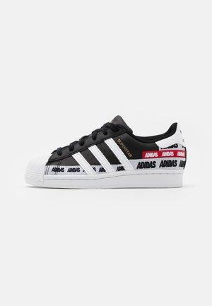 SUPERSTAR UNISEX - Trainers - core black/footwear white/gold metallic