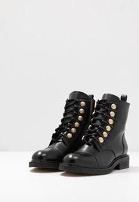 Billi Bi - Lace-up ankle boots - black/gold - 4