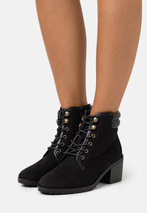 WIDE FIT PADDED BACK HEELED HIKER BOOT - Lace-up ankle boots - black
