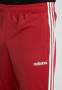 adidas Performance - 3 STRIPES SPORTS REGULAR PANTS - Träningsbyxor - red/white - 4
