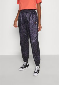 Nike Sportswear - Tracksuit bottoms - dark raisin/bright mango - 0