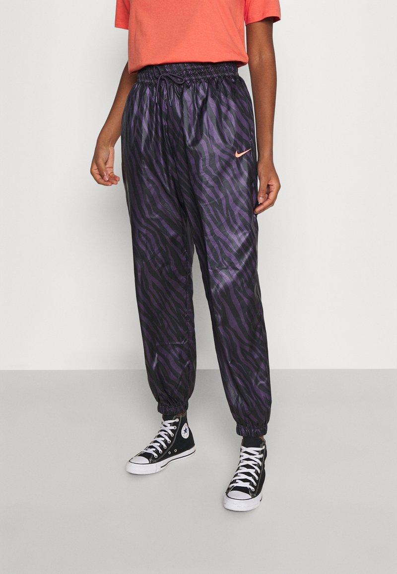 Nike Sportswear - Tracksuit bottoms - dark raisin/bright mango