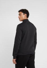 EA7 Emporio Armani - Zip-up hoodie - black - 2