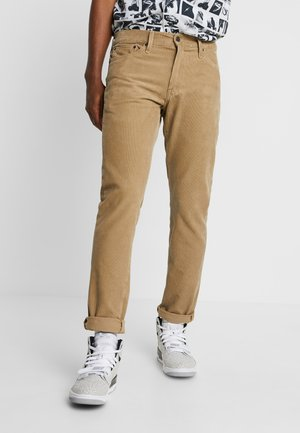 511™ SLIM FIT - Trousers - beige
