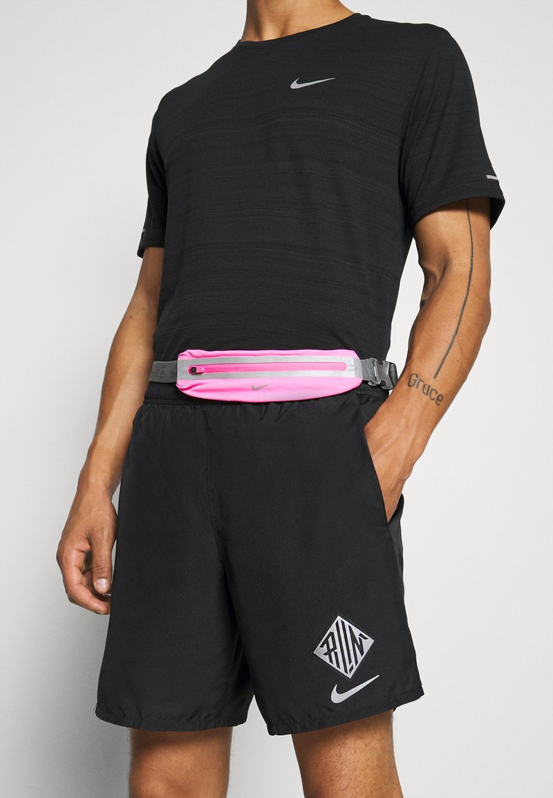 Nike Performance - SLIM WAISTPACK 2.0 UNISEX - Bum bag - pink glow/smoke