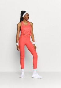 Nike Performance - MILER TANK RACER - Sportshirt - bright mango/reflective silver - 1