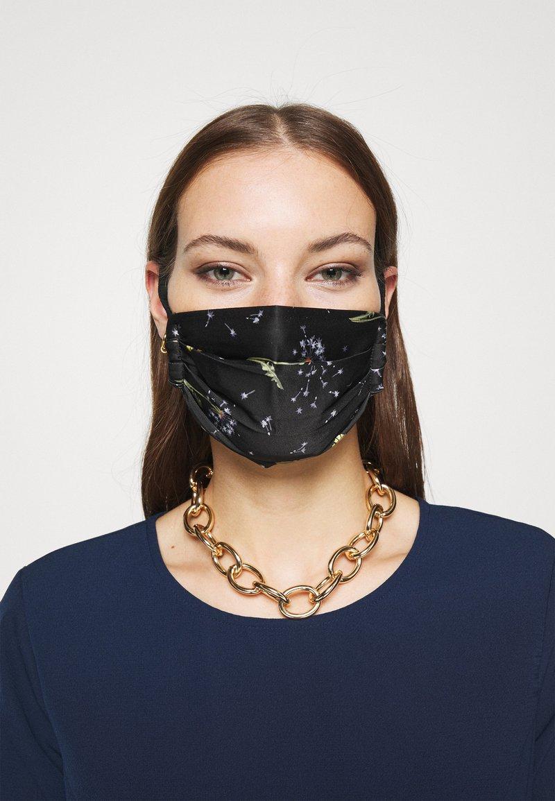 By Malene Birger - DANDELION RAMIA - Community mask - black