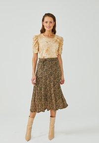 Aaiko - FRAIDA - A-line skirt - black dessin - 1