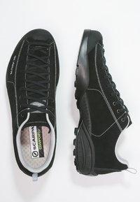Scarpa - MOJITO UNISEX - Hiking shoes - black - 1