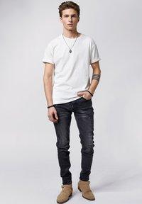 Tigha - Slim fit jeans - vintage black - 1