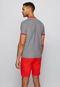 BOSS - PAULE 4 - Polo shirt - black - 2