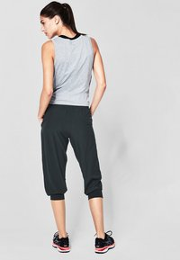s.Oliver active - 3/4 sports trousers - black - 2