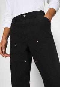 Carhartt WIP - DOUBLE KNEE PANT DEARBORN - Pantalon classique - black rinsed - 5