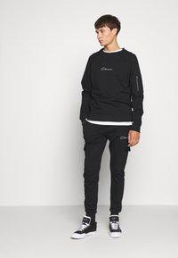 CLOSURE London - UTILITY JOGGER - Spodnie treningowe - black - 1