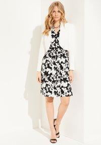 comma - Jersey dress - black floral print - 1
