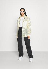 Nike Sportswear - SUMMERIZED - Summer jacket - coconut milk/black - 1