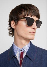 Gucci - Sunglasses - black/gold-coloured/grey - 1