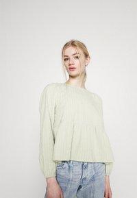 Monki - MARIA PEPLUM BLOUSE - Long sleeved top - green dusty light - 3